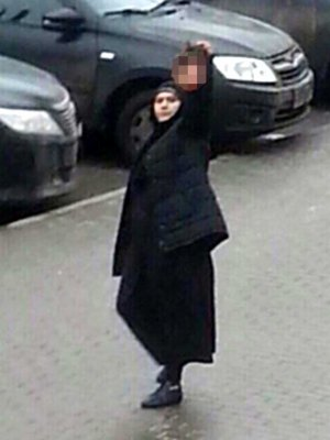 Russia: woman in burka holding severed head of child